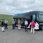 Group outside new Electric Bus
